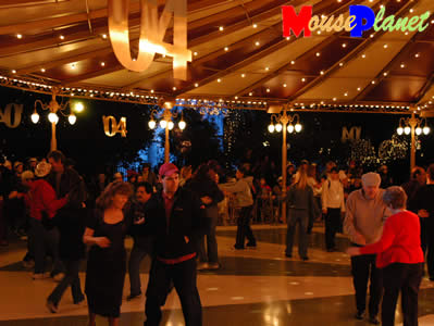 Dancers swing in the new year at the Plaza Gardens. Photo by Adrienne Vincent-Phoenix, copyright MousePlanet.