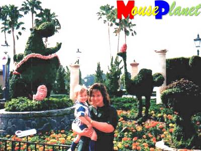 Barbara & Allan in front of several Fantasia topiary.