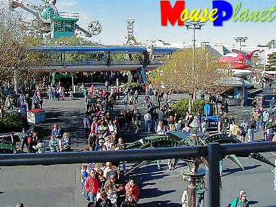A view back at the TTA loading area with the Space Mountain line in the foreground.