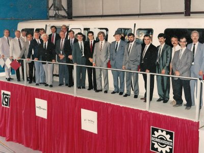 The Mark VI monorail team poses in front of the full-scale mockup at the Bombardier plant. Pictured include Dick Nunis (second from left), Marty Sklar (fourth from left), George McGinnis (seventh from left), Dan Welsh (eighth from left), Paul Larouche (tenth from right), and John Hench (seventh from right, in hat). Photo courtesy of Paul Larouche, from the collection of George McGinnis.